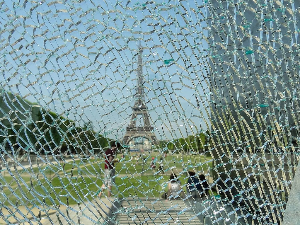 Eiffel Tower through shattered glass